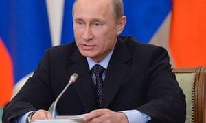 Vladimir Putin speaks after a summit with European Union leaders