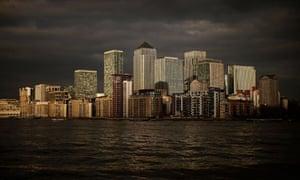 Evening light illuminates the buildings of Canary Wharf