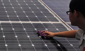 Workers cleaning solar panels on display at the Yingli Green Energy Holdings Co in Baoding, Hebei Province, China