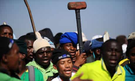 Striking Lonmin mine workers gather during industrial action last month