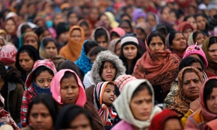 Indian women attend a prayer ceremony for a rape victim after a demonstration