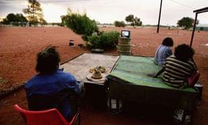 Indigenous Australians watch TV in Utopia, Australia