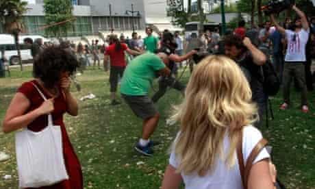 Turkish riot policeman uses tear gas 5