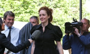 Members of the media gather around former News International chief executive Rebekah Brooks as she arrives at a court in London to enter a plea to charges related to phone hacking.