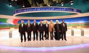 Presidential candidates from left, Saeed Jalili, Gholam Ali Haddad Adel, Mohammad Bagher Qalibaf, Ali Akbar Velayati, Mohammad Gharazi, Mohammad Reza Aref, Hasan Rowhani, Mohsen Rezaei, pose for a group picture, after the last TV debate on Friday 31 May 2013.