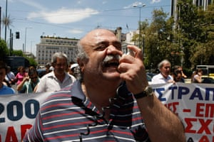 A blind protester chants slogans outside of the Greek parliament. Blind groups marched to the office of conservative Prime Minister Antonis Samaras to protest ongoing health care benefit cuts in the bailed out country.