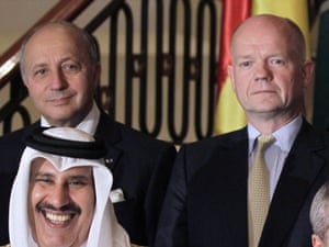 The British and French foreign ministers, William Hague and Laurent Fabius stand behind the Qatari prime minister at last month's Friends of Syria meeting in Jordan.