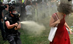 Shower of pepper spray turns woman in a red dress into Turkey's image of resistance