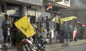 Residents of Qusair wave the Syrian national flag and flags of Lebanese Shia group Hezbollah in celebration after government forces seized total control of the former rebel-stronghold. The US condemned the assault by Syrian troops on Qusair, claiming the regime had had to depend on Hezbollah to win the battle