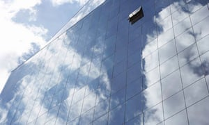 Clouds reflected in windows of office building