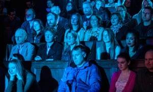 A theatre audience sat down