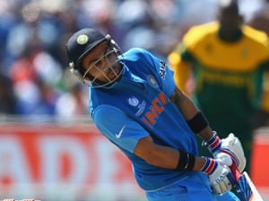 Virat Kohli is hit by a delivery from Ryan McLaren.