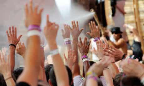 Festivalgoers raise their hands at Coachella festival
