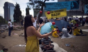 A woman juggles as protestors spend their day at Gezi Park in Taksim Square on June 6, 2013 in Istanbul, Turkey. The protests began initially over the fate of Taksim Gezi Park, one of the last significant green spaces in the center of the city.