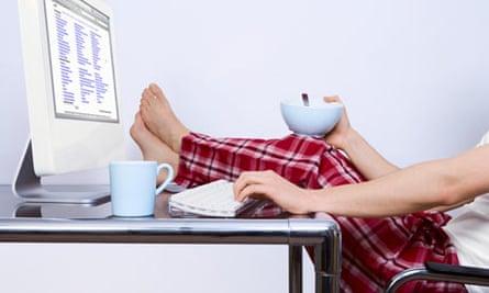 man in pyjamas putting feet up