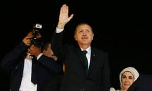 Tayyip Erdogan waves to supporters after arriving in Istanbul early on Friday morning.