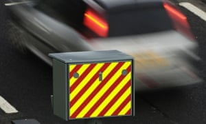 A car passing a speed camera.