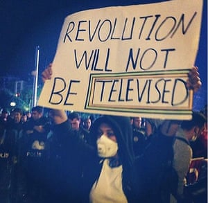 Turkey demonstrations: demonstrator holding sign