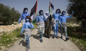 Demonstators dressed like the Na'vi characters from Avatar near Ramallah, February 2010.