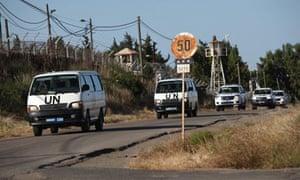 A UN convoy near the Quneitra border crossing between Israel and Syria