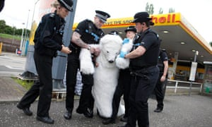 Polar bear costumed Greenpeace activist is removed from a Shell petrol station in Edinburgh.