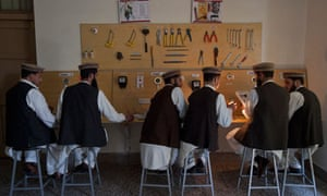 Learning a trade ... men study electronics at the Swat valley centre