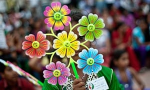 An Indian girl holds a flower-shaped pinwheel during a Day of Action against Global Hunger event