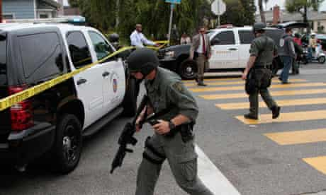 A Swat officer walks near the campus of Santa Monica College