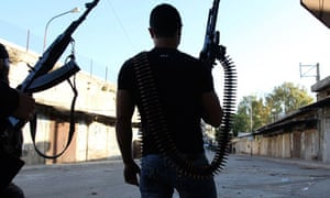 Two Sunni gunmen in the northern Lebanese town of Tripoli where fighting has killed 25 people in eig