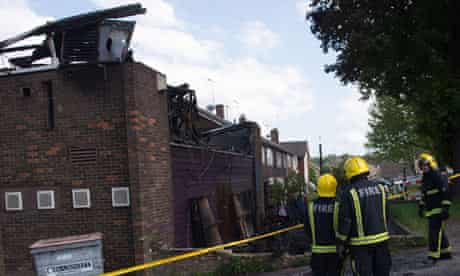 Fire officers survey the fire damaged Bravanese Islamic centre in Muswell Hill