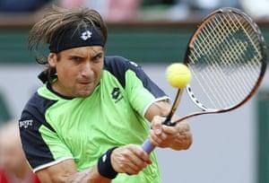 tennis: Spain's David Ferrer returns to Spain's