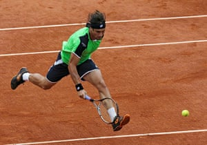 sport2: David Ferrer of Spain hits a return to compatriot Rafael Nadal during their