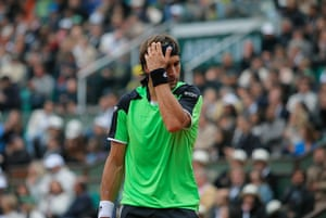 tennis2: Spain's David Ferrer reacts as he plays compatriot Rafael Nadal during the