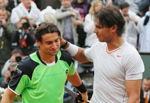 tennis7: Rafael Nadal (R) of Spain pats compatriot David Ferrer on the back after wi