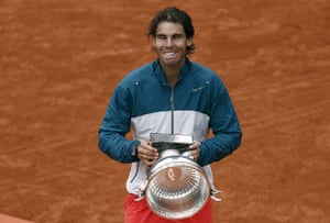 tennis7: Spain's Rafael Nadal celebrates with the trophy following his victory over
