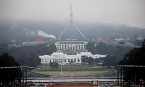 The fog starts to lift around the Parliamentary triangle in Canberra this morning. The Global Mail.