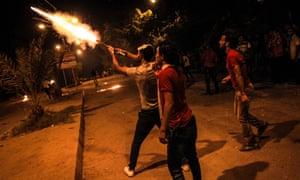 Anti-Morsi protesters attack the Muslim Brotherhood headquarters in Al-Moqattam, Cairo.