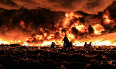 Firefighters tackle the blaze at a recycling plant.