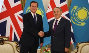 Kazakhstan's President Nursultan Nazarbayev (R) shakes hands with David Cameron during a meeting in Astana July 1, 2013.