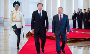 David Cameron (C) walks with Kazakhstan President Nursultan Nazarbayev (R) after arriving at the Presidential Palace in Astana, Kazakhstan on July 1, 2013.