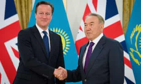 British Prime Minister David Cameron (L)
