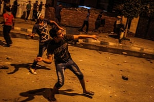 Egypt protest: Anti-Morsi protesters throw stones at the Muslim Brotherhood headquarters i