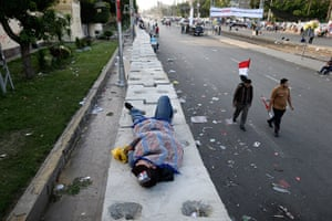 Egypt protest: An opponent of Morsi sleeps outside the presidential palace