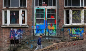 Children look through a broken window in the abandoned convent known as Gesu, in Brussels, Belgium. Around 160 squatters face expulsion when a €90m project by a Swiss developer to turn their dwellings into a luxury hotel and apartments gets the go-ahead. The Gesu church and convent have remained vacant for decades and were bought by Swiss developer Rosebud Heritage in 2007, who agreed that the property could be used as a squat until the works started.