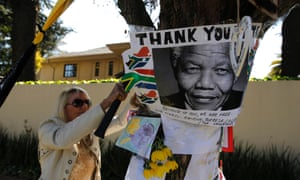 Meanwhile in South Africa a message of support is posted outside the home of former president Nelson Mandela in Houghton, Johannesburg. Photograph: Thomas Mukoya/Reuters