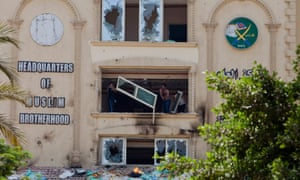 Protesters throw furniture from the windows of the headquarters of Egypt's Muslim Brotherhood as they ransack the building in Cairo.