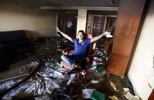 Egypt update: A looter sits on a chair at the Muslim Brotherhood's headquarters after it