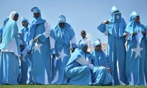 People dressed in the colours of the Somali flag gather for a celebration to mark Somalia's Independence Day at Konis Stadium in Mogadishu, Somalia.