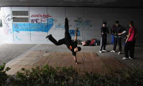 Young people breakdancing in Athens