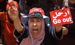An Egyptian woman shouts slogans during a protest against President Mohammed Morsi in Cairo